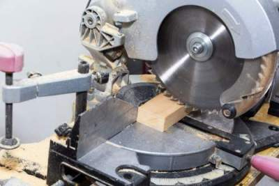 working with 12 inch miter saw in woodshop