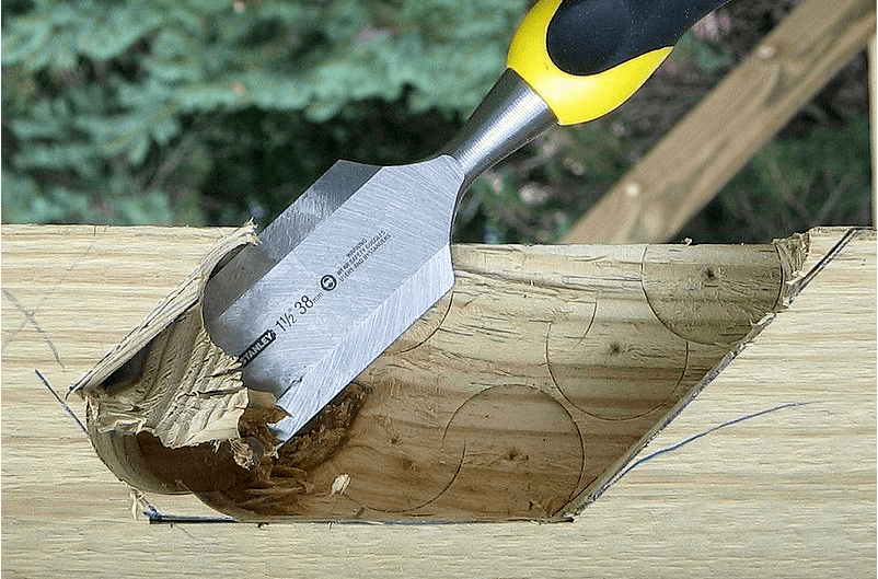 Cutting wood with Chisel